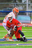 Baldwinsville Bees Evan Stolicker (32) faces off against Liverpool Warriors Kendall Keahey (12) in Boys Lacrosse on Tuesday, April 29, 2014 at Liverpool, New York, Liverpool won 14-13 in overtime.