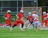 Liverpool Warriors Kendall Keahey (12) fires in a goal past Baldwinsville Bees defenders in Boys Lacrosse on Tuesday, April 29, 2014 at Liverpool, New York, Liverpool won 14-13 in overtime.