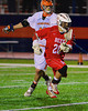 Baldwinsville Bees Luke McCaffrey (20) gets past a Liverpool Warriors defender in Boys Lacrosse on Tuesday, April 29, 2014 at Liverpool, New York, Liverpool won 14-13 in overtime.