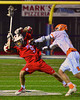 Baldwinsville Bees Stephen Petrelli (9) is checked by Liverpool Warriors Kendall Keahey (12) in Boys Lacrosse on Tuesday, April 29, 2014 at Liverpool, New York, Liverpool won 14-13 in overtime.