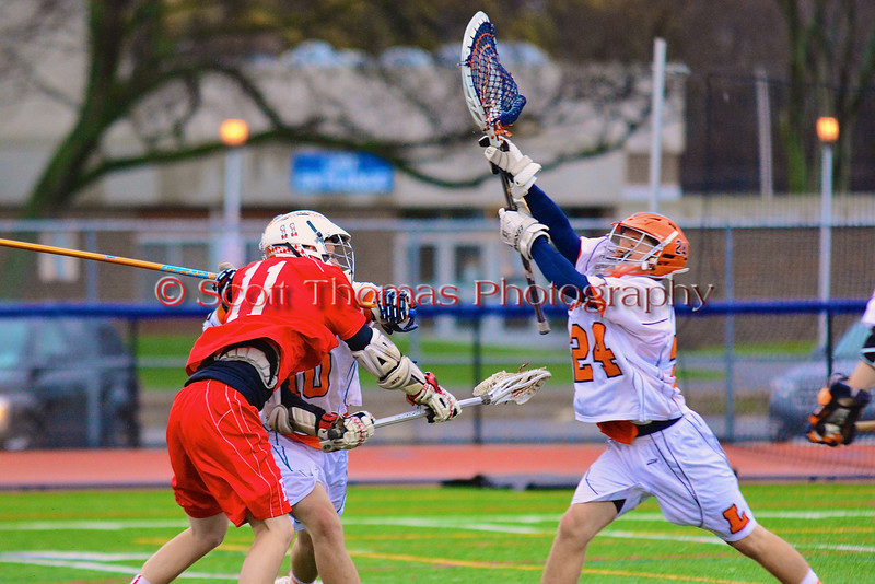 Baldwinsville Bees Sean Barron (11) shoots and scores past Liverpool Warriors goalie Kyle Halladay (24) in Boys Lacrosse on Tuesday, April 29, 2014 at Liverpool, New York, Liverpool won 14-13 in overtime.