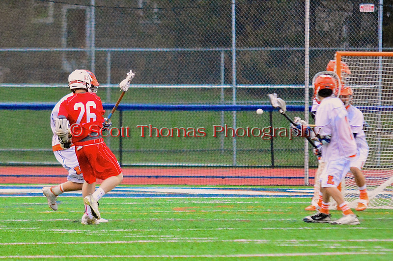 Baldwinsville Bees Connor Smith (26) shoots and scores against the Liverpool Warriors in Boys Lacrosse on Tuesday, April 29, 2014 at Liverpool, New York, Liverpool won 14-13 in overtime.