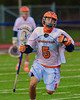Liverpool Warriors Matthew Sala (5) bringing the ball up field against the Baldwinsville Bees in Boys Lacrosse on Tuesday, April 29, 2014 at Liverpool, New York, Liverpool won 14-13 in overtime.