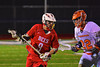 Baldwinsville Bees Stephen Petrelli (9) being defended by Liverpool Warriors Peter Sterio (22) in Boys Lacrosse on Tuesday, April 29, 2014 at Liverpool, New York, Liverpool won 14-13 in overtime.