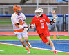 Baldwinsville Bees Sean Barron (11) cradling the ball against Liverpool Warriors defender Ryan Spiker (21) in Boys Lacrosse on Tuesday, April 29, 2014 at Liverpool, New York, Liverpool won 14-13 in overtime.