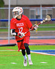 Baldwinsville Bees Connor Chapman (12) with the ball against Liverpool Warriors in Boys Lacrosse on Tuesday, April 29, 2014 at Liverpool, New York, Liverpool won 14-13 in overtime.