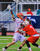 Liverpool Warriors Kendall Keahey (12) trying to get past Baldwinsville Bees William Hamm Jr. (7) in Boys Lacrosse on Tuesday, April 29, 2014 at Liverpool, New York, Liverpool won 14-13 in overtime.