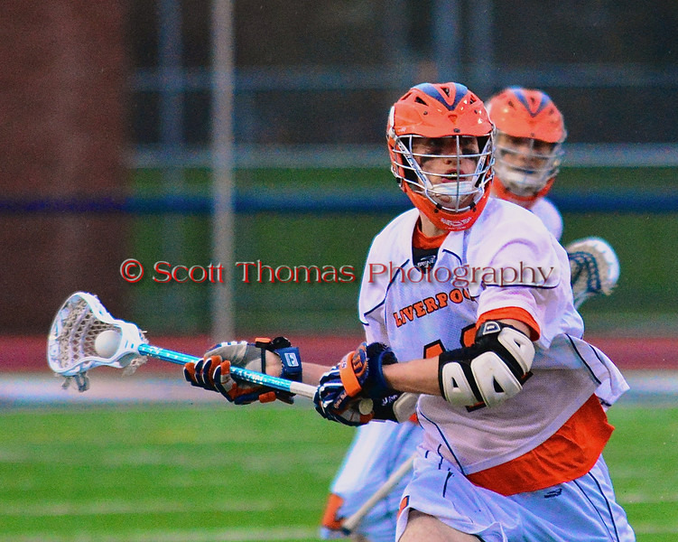 Liverpool Warriors Kendall Keahey (12) looking to make a play against the Baldwinsville Bees in Boys Lacrosse on Tuesday, April 29, 2014 at Liverpool, New York, Liverpool won 14-13 in overtime.