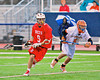 Baldwinsville Bees Stephen Petrelli (9) getting around Liverpool Warriors defender Matthew Sala (5) in Boys Lacrosse on Tuesday, April 29, 2014 at Liverpool, New York, Liverpool won 14-13 in overtime.