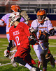 Baldwinsville Bees Connor Chapman (12) breaks around a Liverpool Warriors defender in Boys Lacrosse on Tuesday, April 29, 2014 at Liverpool, New York, Liverpool won 14-13 in overtime.