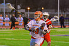 Liverpool Warriors Antonio Rey (13) gets past Baldwinsville Bees defender Eric Candee (10) in Boys Lacrosse on Tuesday, April 29, 2014 at Liverpool, New York, Liverpool won 14-13 in overtime.