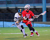 Baldwinsville Bees Kyle Akers (25) being closely watched by  West Genesee Wildcats Derek Farrell (10) in Boys Lacrosse on Tuesday, April 8, 2014 at Camillus, New York. West Genesee won 8-5.