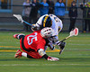 Baldwinsville Bees Kyle Akers (25) gets checked by West Genesee Wildcats Alex Scicchitano (22) in Boys Lacrosse on Tuesday, April 8, 2014 at Camillus, New York. West Genesee won 8-5.