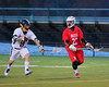 Baldwinsville Bees Jake Anderson (22) being watched by West Genesee Wildcats Mike Geremia (9) in Boys Lacrosse on Tuesday, April 8, 2014 at Camillus, New York. West Genesee won 8-5.