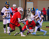 Baldwinsville Bees Connor Chapman (12) with the ball against the West Genesee Wildcats in Boys Lacrosse on Tuesday, April 8, 2014 at Camillus, New York. West Genesee won 8-5.
