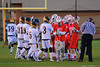 Baldwinsville Bees and West Genesee Wildcats performing the pre-game greeting in Boys Lacrosse on Tuesday, April 8, 2014 at Camillus, New York. West Genesee won 8-5.