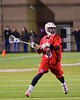 Baldwinsville Bees Luke McCaffrey (20) with the ball against the West Genesee Wildcats in Boys Lacrosse on Tuesday, April 8, 2014 at Camillus, New York. West Genesee won 8-5.