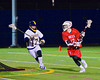 Baldwinsville Bees Connor Chapman (12) being defended by West Genesee Wildcats Nick Mellen (17) in Boys Lacrosse on Tuesday, April 8, 2014 at Camillus, New York. West Genesee won 8-5.