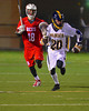 West Genesee Wildcats Collin Kobuszewski (20) being chased by Baldwinsville Bees Kyle Terrell (18) in Boys Lacrosse on Tuesday, April 8, 2014 at Camillus, New York. West Genesee won 8-5.
