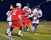 Baldwinsville Bees Stephen Petrelli (9) scores with West Genesee Wildcats defenders draped all over him in Boys Lacrosse on Tuesday, April 8, 2014 at Camillus, New York. West Genesee won 8-5.