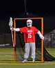 Baldwinsville Bees goalie Daniel Thomas (15) directing traffic against the West Genesee Wildcats in Boys Lacrosse on Tuesday, April 8, 2014 at Camillus, New York. West Genesee won 8-5.