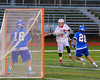 Baldwinsville Bees Matt Klein (8) gets a shot off at the Oswego Buccaneers net in Section III Boys Lacrosse action in Fulton, New York on Thursday, May 1, 2014.  Baldwinsville won 13-9.