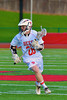 Baldwinsville Bees Connor Smith (26) cradling the ball against the Oswego Buccaneers in Section III Boys Lacrosse action in Fulton, New York on Thursday, May 1, 2014.  Baldwinsville won 13-9.