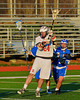 Baldwinsville Bees Charlie Bertrand (24) lines up a shot at the Oswego Buccaneers net in Section III Boys Lacrosse action in Fulton, New York on Thursday, May 1, 2014.  Baldwinsville won 13-9.