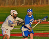 Oswego Buccaneers Zach Crisafulli (19) being watched closely by Baldwinsville Bees Tyler Gornick (13) in Section III Boys Lacrosse action in Fulton, New York on Thursday, May 1, 2014.  Baldwinsville won 13-9.