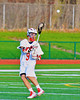 Baldwinsville Bees Stephen Petrelli (9) passing the ball against the Oswego Buccaneers in Section III Boys Lacrosse action in Fulton, New York on Thursday, May 1, 2014.  Baldwinsville won 13-9.