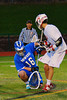 Oswego Buccaneers goalie Trey Love (16) makes a save against a Baldwinsville Bees shooter in Section III Boys Lacrosse action in Fulton, New York on Thursday, May 1, 2014.  Baldwinsville won 13-9.
