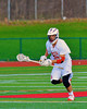 Baldwinsville Bees Luke McCaffrey (20) with the ball after winning the opening face-off against the Oswego Buccaneers in Section III Boys Lacrosse action in Fulton, New York on Thursday, May 1, 2014.  Baldwinsville won 13-9.