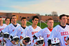 Baldwinsville Bees players stand for the National Anthem before playing the Oswego Buccaneers in Section III Boys Lacrosse action in Fulton, New York on Thursday, May 1, 2014.  Baldwinsville won 13-9.