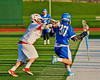 Baldwinsville Bees Cody Luke (3) checks Oswego Buccaneers Mitch Schrader (30) in Section III Boys Lacrosse action in Fulton, New York on Thursday, May 1, 2014.  Baldwinsville won 13-9.