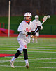 Baldwinsville Bees Matt Brennan (5) looking to make a play against the Oswego Buccaneers in Section III Boys Lacrosse action in Fulton, New York on Thursday, May 1, 2014.  Baldwinsville won 13-9.