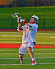 Baldwinsville Bees Stephen Petrelli (9) leans into a shot against the Oswego Buccaneers in Section III Boys Lacrosse action in Fulton, New York on Thursday, May 1, 2014.  Baldwinsville won 13-9.