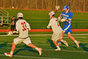 Oswego Buccaneers Brandon Tracz (22) gets a shoot off past Baldwinsville Bees defenders in Section III Boys Lacrosse action in Fulton, New York on Thursday, May 1, 2014.  Baldwinsville won 13-9.