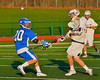 Oswego Buccaneers Austin Batchelor (20) checks a Baldwinsville Bees player in Section III Boys Lacrosse action in Fulton, New York on Thursday, May 1, 2014.  Baldwinsville won 13-9.