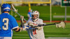 Baldwinsville Bees Sean Barron (11) defending against an Oswego Buccaneers player in Section III Boys Lacrosse action in Fulton, New York on Thursday, May 1, 2014.  Baldwinsville won 13-9.