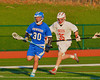 Oswego Buccaneers Mitch Schrader (30) being chased by Baldwinsville Bees Brian Whelan (35) in Section III Boys Lacrosse action in Fulton, New York on Thursday, May 1, 2014.  Baldwinsville won 13-9.