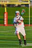 Baldwinsville Bees Evan Stolicker (32) passes the ball against the Oswego Buccaneers in Section III Boys Lacrosse action in Fulton, New York on Thursday, May 1, 2014.  Baldwinsville won 13-9.