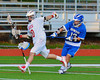 Baldwinsville Bees Eric Candee (10) has the ball stripped by Oswego Buccaneers Garrett Dunsmoor (13) in Section III Boys Lacrosse action in Fulton, New York on Thursday, May 1, 2014.  Baldwinsville won 13-9.