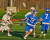 Oswego Buccaneers Garrett Dunsmoor (13) comes out of a scrum with the ball against the Baldwinsville Bees in Section III Boys Lacrosse action in Fulton, New York on Thursday, May 1, 2014.  Baldwinsville won 13-9.