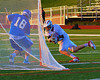 Baldwinsville Bees Sean Barron (11) is stopped in close by Oswego Buccaneers goalie Trey Love (16) in Section III Boys Lacrosse action in Fulton, New York on Thursday, May 1, 2014.  Baldwinsville won 13-9.