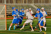 Baldwinsville Bees Connor Chapman (12) has his shot blocked by Oswego Buccaneers goalie Trey Love (16) in Section III Boys Lacrosse action in Fulton, New York on Thursday, May 1, 2014.  Baldwinsville won 13-9.