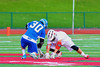 Baldwinsville Bees Luke McCaffrey (20) with the opening face-off against the Oswego Buccaneers Mitch Schrader (30) in Section III Boys Lacrosse action in Fulton, New York on Thursday, May 1, 2014.  Baldwinsville won 13-9.