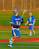Oswego Buccaneers Mitch Schrader (30) with the ball against the Baldwinsville Bees in Section III Boys Lacrosse action in Fulton, New York on Thursday, May 1, 2014.  Baldwinsville won 13-9.
