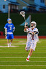 Baldwinsville Bees Eric Candee (10) passes the ball up field against the Oswego Buccaneers in Section III Boys Lacrosse action in Fulton, New York on Thursday, May 1, 2014.  Baldwinsville won 13-9.