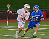 Baldwinsville Bees Connor Chapman (12) working against Oswego Buccaneers  Craig Lawton (7) in Section III Boys Lacrosse action in Fulton, New York on Thursday, May 1, 2014.  Baldwinsville won 13-9.