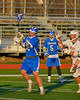 Oswego Buccaneers Brandon Tracz (22) heads in for a shoot on goal against the Baldwinsville Bees in Section III Boys Lacrosse action in Fulton, New York on Thursday, May 1, 2014.  Baldwinsville won 13-9.